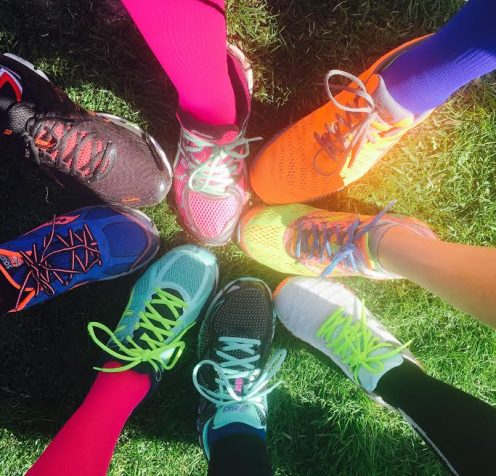 Team wearing colorful compression socks