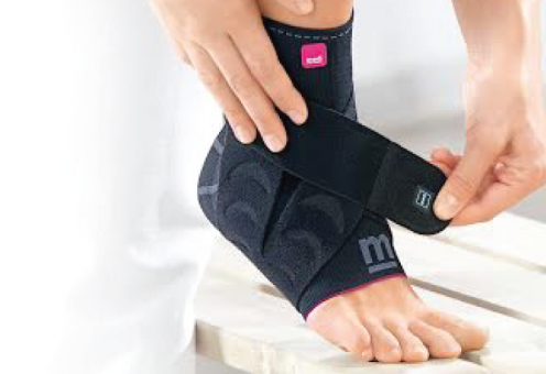 Woman wearing brace on ankle and foot